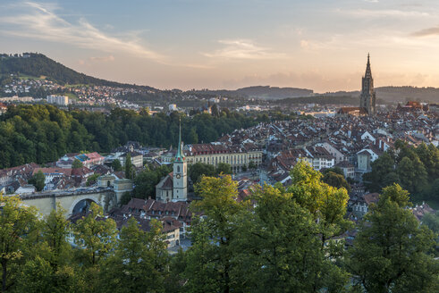 Switzerland, Bern, cityscape with Nydeggkirche and minster in the evening - KEBF00619