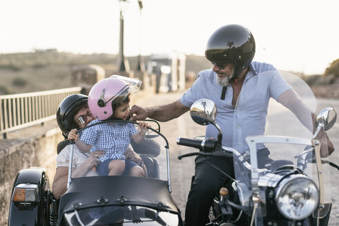 Spain, Jaen, grandfather, grandmother and grandson on motorcycle with a sidecar - JASF01829