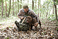 Man with dog in forest - MFRF01004