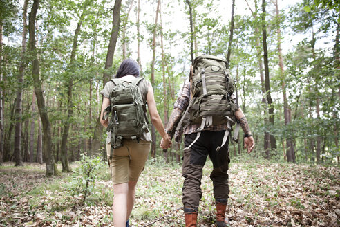 Couple with backpacks on a hiking trip in forest - MFRF01007