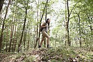 Young woman with backpack on a hiking trip in forest - MFRF01010