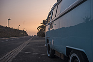 Spain, old van parking at roadside by sunset - SIPF01689