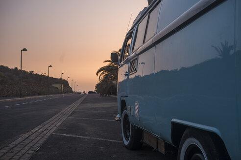 Spain, old van parking at roadside by sunset - SIPF01689