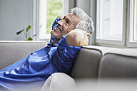 Relaxed mature man sitting on couch at home - RBF05898