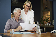 Mature couple with documents at home - RBF05913