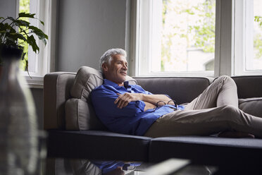 Pensive mature man lying on couch at home - RBF05949