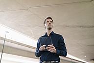 Businessman using portable glass device - KNSF02489