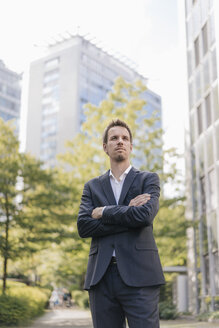 Portrait of confident businessman in the city - KNSF02528
