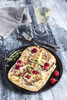 Homemade pizza with zucchini, mozzarella, ricotta, bacon and raspberries - SARF03358