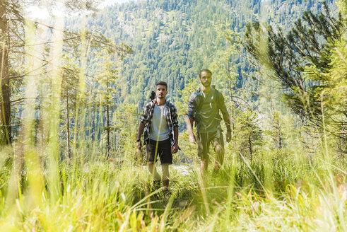 Germany, Bavaria, two friends hiking - DIGF02778