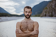 Germany, Bavaria, portrait of shirtless young man in nature - DIGF02844