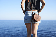 Back view of woman looking at the sea, partial view - IGGF00154