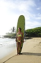 Woman on the beach with surfboard - ECPF00063