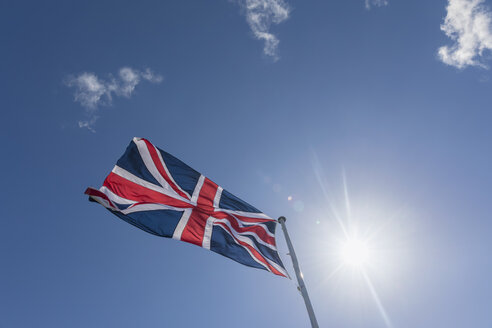 Union Jack in blue sky with backlight - FOF09323