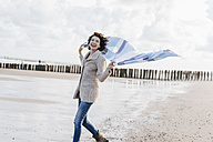 Happy woman with cloth on the beach - KNSF02561
