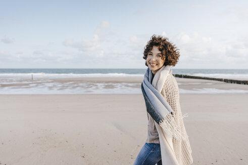 Portrait of happy woman on the beach - KNSF02630