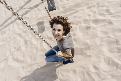 Happy woman on a swing - KNSF02675