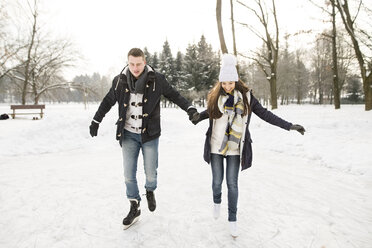 Couple ice skating on a frozen lake - HAPF02112