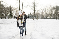 Couple ice skating on a frozen lake - HAPF02115