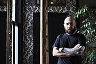 Portrait of tattoo artist in studio - IGGF00169