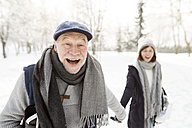 Happy senior couple in winter landscape - HAPF02136