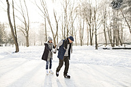 Senior couple ice skating - HAPF02157