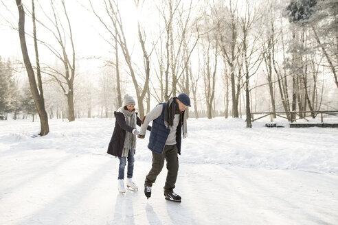 Senior couple ice skating - HAPF02157