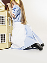 Little girl dressed up as Alice in Wonderland with doll's house - FSF00960