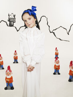 Portrait of little girl dressed up as Snow White with six dwarfs - FSF00972