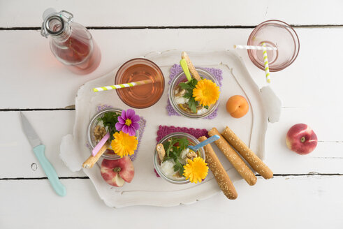 Salad to go in jars, bread sticks and glass of lemonade on tray - ECF01891