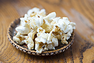 Wood bowl of popcorn - MYF01952