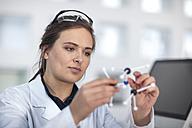 Scientist working in lab holding molecular structure - ZEF14598