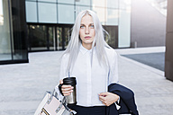 Portrait of serious young businesswoman in the city - GIOF03221