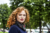 Portrait of redheaded young woman with red lips - FMKF04490