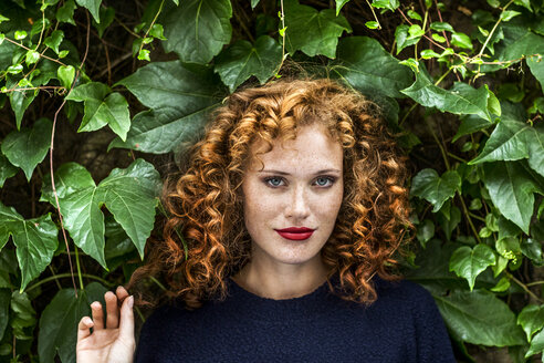 Portrait of redheaded young woman with red lips - FMKF04493