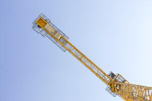 Yellow crane against blue sky - MMAF00123