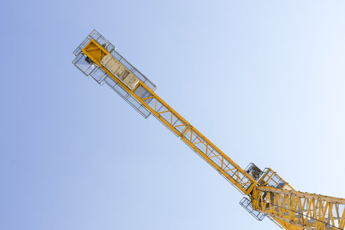 Yellow crane against blue sky - MMAF00123