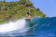 Indonesia, Bali, woman surfing - KNTF00888