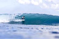 Indonesia, Bali, man surfing - KNTF00894