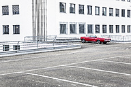 Red sports car on parking level - FMKF04516