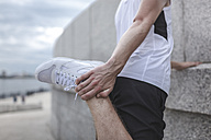Close-up of athlete stretching outdoors - VPIF00074