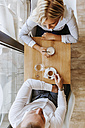 Woman and man drinking coffee in a cafe - ZEDF00852