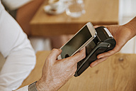 Contactless payment with smartphone in cafe - ZEDF00879