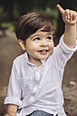 Portrait of smiling toddler raising his finger - MFF03962