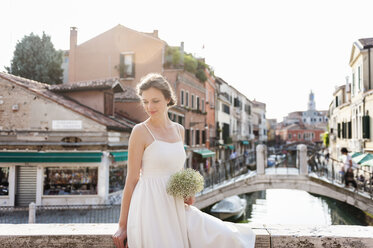 Italy, Venice, smiling bride with bridal bouquet - DIGF02864