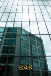 Switzerland, Zurich, glass facade of Prime Tower with bar sign - NG00418