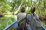 Dominican Republic, Samana, two women in a boat in mangrove lagoon - ECPF00115