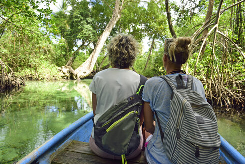 Dominican Republic, Samana, two women in a boat in mangrove lagoon - ECPF00115