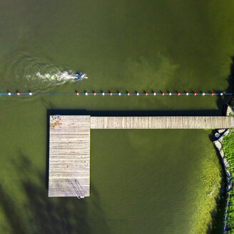 Aerial view of man swimming in a lake - STSF01316