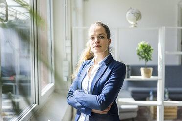 Portrait of confident businesswoman in a loft - JOSF01755